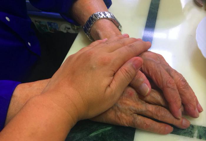 elderly hands lightened